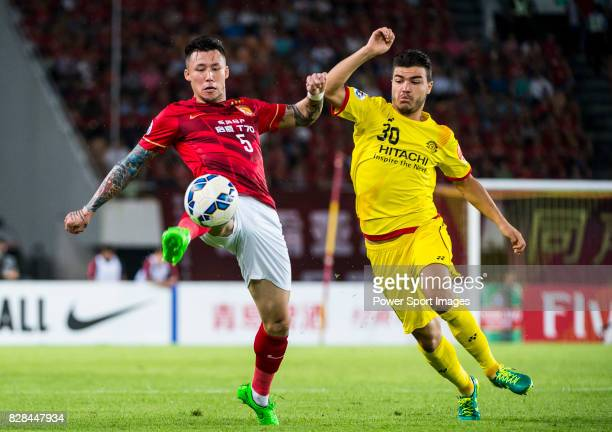 Guangzhou Evergrande defender Zhang Linpeng fights for the ball with Kashiwa Reysol forward Cristiano Da Silva during the Guangzhou Evergrande vs...