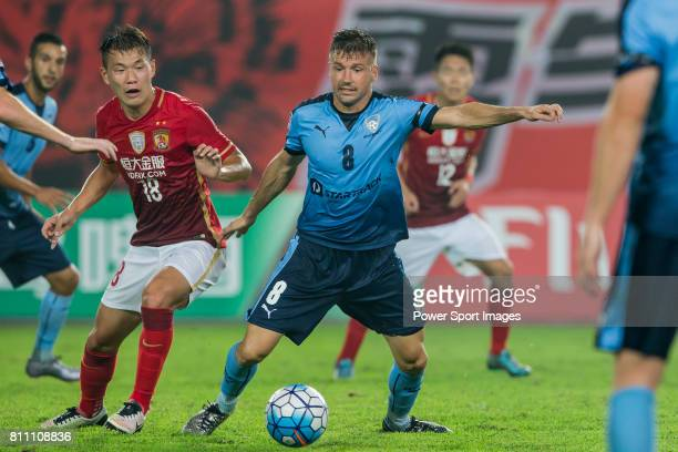 Guangzhou Evergrande forward Li Yuanyi fights for the ball with Sydney FC midfielder Milos Dimitrijevic during the AFC Champions League 2016 - Group...