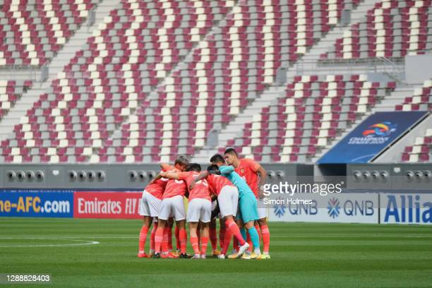Guangzhou Evergrande huddle before the AFC Champions League Group G match between Guangzhou Evergrande and Suwon Samsung Bluewings at the Khalifa...