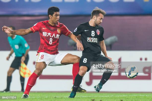 Guangzhou Evergrande midfielder Bezerra Maciel Junior fights for the ball with Al Ahli midfielder Everton Augusto De Barros Ribeiro during the AFC...