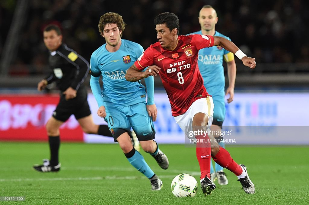 Guangzhou Evergrande midfielder Paulinho controls the ball against Barcelona during their Club World Cup semi-final football match in Yokohama on December 17, 2015.