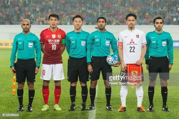 Guangzhou Evergrande midfielder Zheng Zhi and Urawa Red Diamonds midfielder Abe Yuki poses for photos among referees during the AFC Champions League...