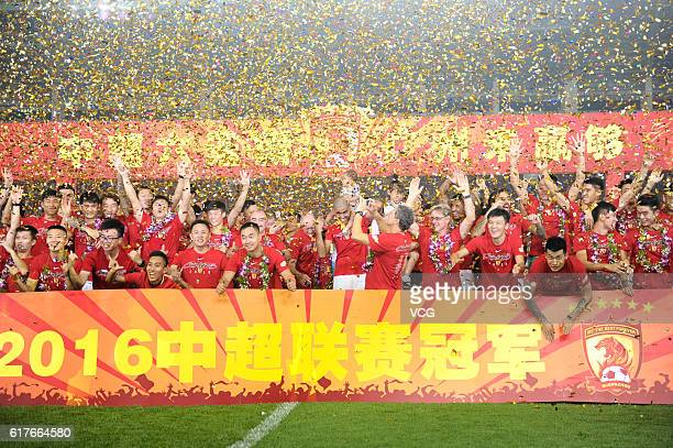 Guangzhou Evergrande players celebrate winning the 2016 Chinese Super League title after the 28th round match between Guangzhou Evergrande and...
