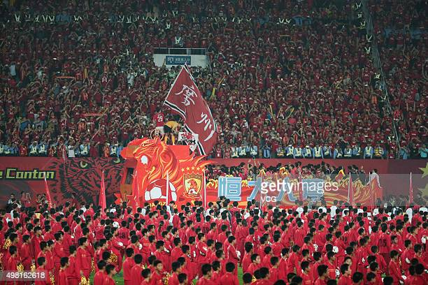 Guangzhou Evergrande players celebrate with fans after winning the second leg of the AFC Champions League final match between Guangzhou Evergrande...