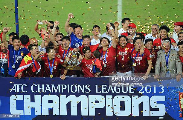 Guangzhou Evergrande players celebrate with the AFC Champions League Final Tropy after winning the 2013 AFC Champions League final at Guangzhou...