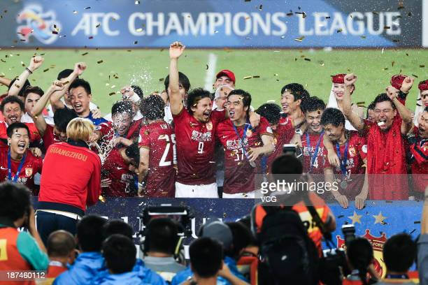 Guangzhou Evergrande players celebrate with the trophy after winning the AFC Champions League Final 2nd leg match against FC Seoul at Tianhe Sports...