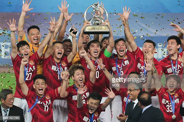 Guangzhou Evergrande players celebrate with the trophy after winning the second leg of the AFC Champions League final match between Guangzhou...