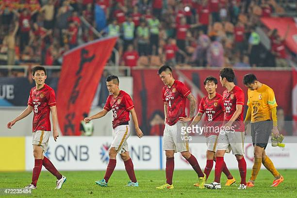 Guangzhou Evergrande players react after the AFC Asian Champions League Group H match between Guangzhou Evergrande and Western Sydney Wanderers at...