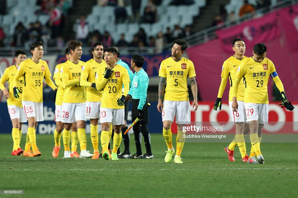 Guangzhou Evergrande players react after the scoreless draw in the AFC Champions League Group G match between Cerezo Osaka and Gunazhou Evergrande at the Yanmar Stadium Nagai on February 21, 2018 in Osaka, Japan.