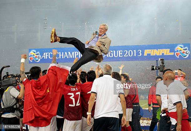 Guangzhou Evergrande players throw head coach Marcello Lippi up after winning the AFC Champions League Final 2nd leg match against FC Seoul at Tianhe...