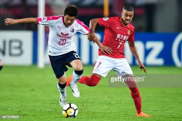 Guangzhou Evergrande's Alan Douglas fights for the ball with Cerezo Osaka's Noriyuki Sakemoto during the AFC Champions League group stage football...