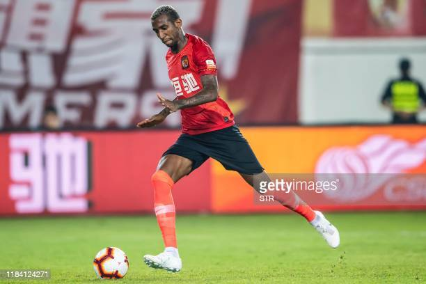 Guangzhou Evergrande's Anderson Talisca controls the ball during the Chinese Super League football match between Guangzhou Evergrande and Shanghai...