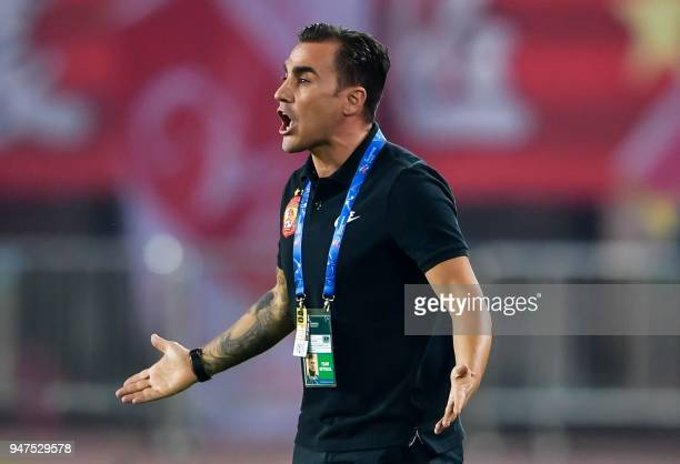 Guangzhou Evergrande's head coach Fabio Cannavaro reacts during the AFC Champions League group stage football match between China's Guangzhou...