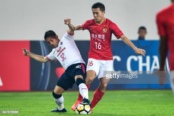 Guangzhou Evergrande's Huang Bowen fights for the ball with Cerezo Osaka's Atomu Tanaka during the AFC Champions League group stage football match...