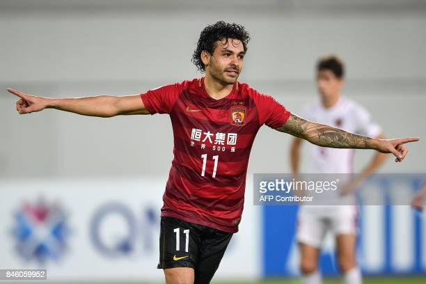 Guangzhou Evergrande's Ricardo Goulart celebrates after scoring a goal during their AFC Champions League quarterfinal football match against Shanghai...