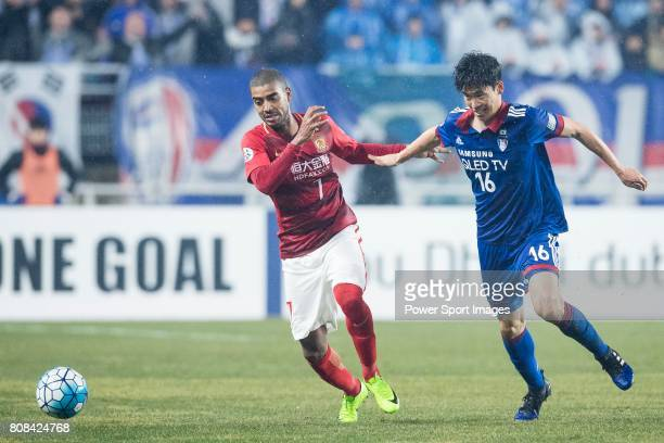 Guangzhou Forward Alan Douglas De Carvalho fights for the ball with Suwon Midfielder Lee Jong Sung during the AFC Champions League 2017 Group G match...