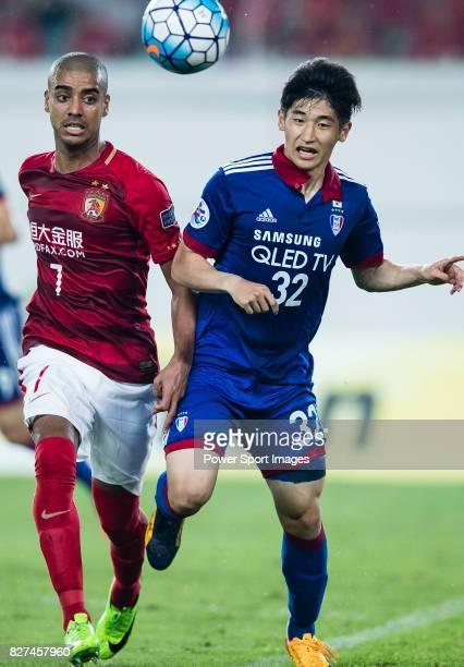 Guangzhou Forward Alan Douglas De Carvalho plays against Suwon Defender Jang Hoik during the AFC Champions League 2017 Group G match between...