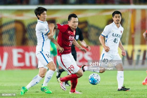 Guangzhou Forward Gao Lin fights for the ball with Kashima Defender Yamamoto Shuto during the AFC Champions League 2017 Round of 16 match between...