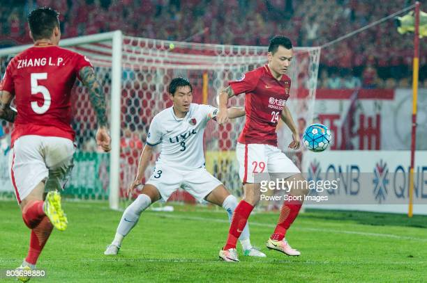 Guangzhou Forward Gao Lin fights for the ball with Kashima Defender Shoji Gen during the AFC Champions League 2017 Round of 16 match between...