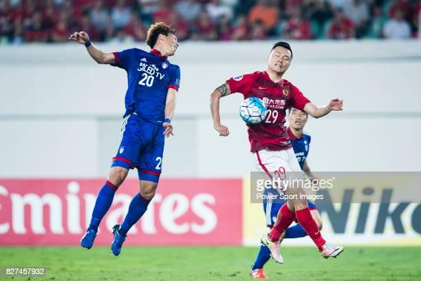 Guangzhou Forward Gao Lin fights for the ball with Suwon Forward Yu Hanchao during the AFC Champions League 2017 Group G match between Guangzhou...