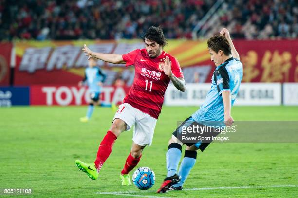 Guangzhou Forward Ricardo Goulart in action against Kawasaki defender Noborizato Kyohei during the AFC Champions League 2017 Group G match between...