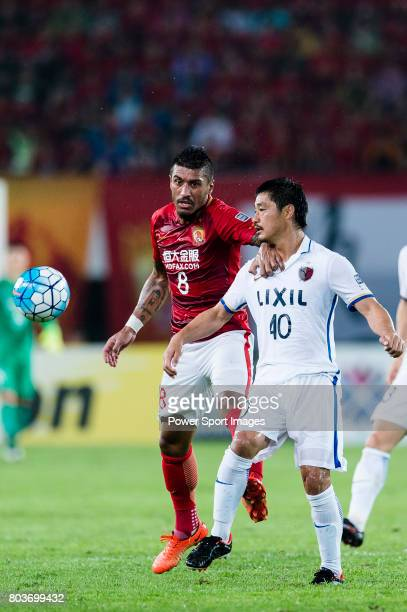 Guangzhou Midfielder Paulinho Maciel fights for the ball with Kashima Midfielder Ogasawara Mitsuo during the AFC Champions League 2017 Round of 16...