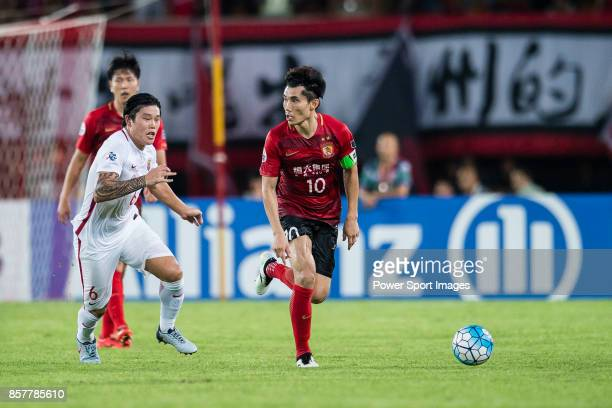 Guangzhou Midfielder Zheng Zhi in action against Shanghai FC Midfielder Cai Huikang during the AFC Champions League 2017 QuarterFinals match between...