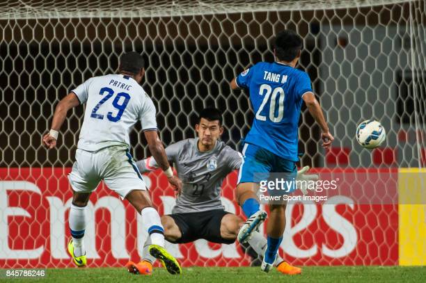 Guangzhou RF goalkeeper Liu Dianzuo reaches for the ball after an attempt at goal by Gamba Osaka forward Anderson Patric Aguiar Oliveira during the...
