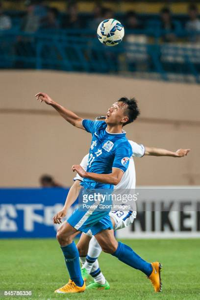 Guangzhou RF midfielder Chang Feiya fights for the ball with Gamba Osaka midfielder Ogura Shohei during the 2015 AFC Champions League Group Stage F...