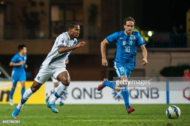Guangzhou RF midfielder Miguel Javaloyas fights for the ball with Gamba Osaka forward Anderson Patric Aguiar Oliveira during the 2015 AFC Champions...