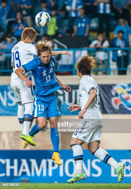 Guangzhou RF midfielder Ye Chugui fights for the ball with Gamba Osaka midfielder Omori Kotaro during the 2015 AFC Champions League Group Stage F...