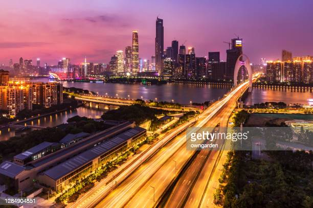 guangzhou skyscrapers at sunset - china east asia stock pictures, royalty-free photos & images