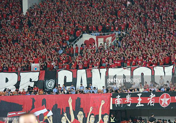 Guangzhou supporters cheer for Guangzhou Evergrande during the AFC Champions League Semi Final Second Round match between Guangzhou Evergrande and...