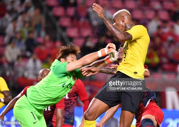 TOPSHOT Guangzhou's midfielder Anderson Talisca heads to score a goal in front of Kashima's goalkeeper Kuwon SunTae during the AFC Champions League...