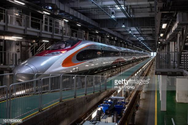 A GuangzhouShenzhenHong Kong Express Rail Link 'Vibrant Express' train is seen at Shek Kong Stabling Sidings in Hong Kong on August 16 2018 The...