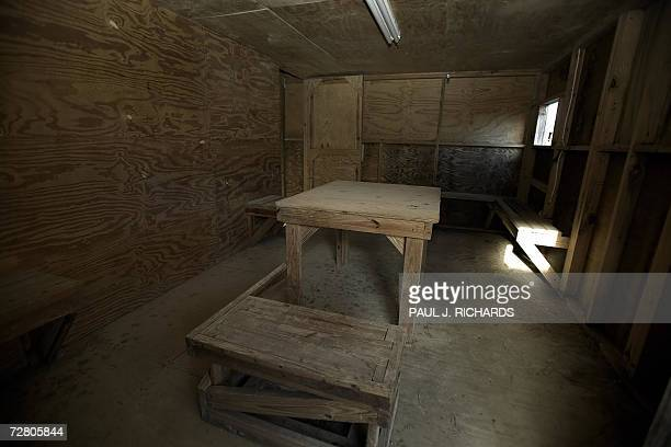 An interrogation room used by US military officials is pictured at the closed Camp XRay now overgrown with grass and weeds 05 December 2006 at the US...