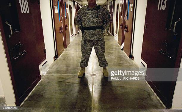 In this 24 April 2007 file photo a guard inside the maximun security Camp 5 at Camp Delta in Guantanamo Bay Naval Station Cuba stands his post in a...
