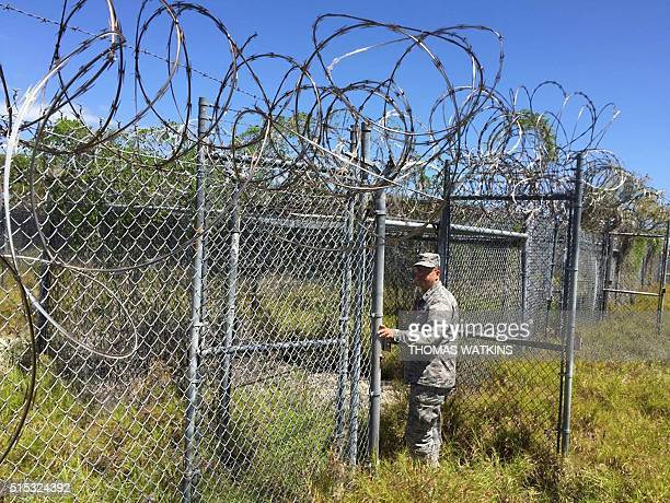 Guantanamo spokesman Lieutenant Colonel Michael Meridith enters abandoned Camp XRay at Guantanamo Bay Naval base on March 9 in Guantanamo Bay Cuba...