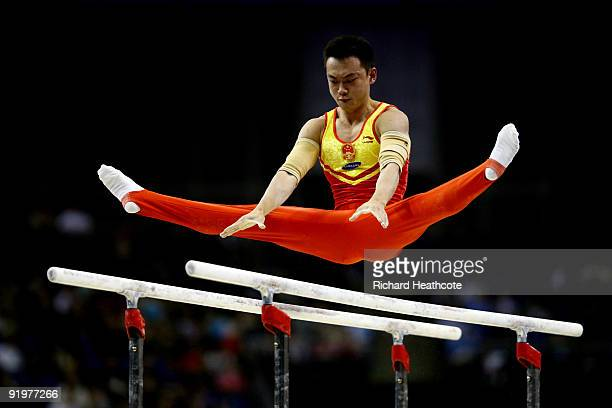 Guanyin Wang of China competes in the parallel bars during the Apparatus Finals on the sixth day of the Artistic Gymnastics World Championships 2009...