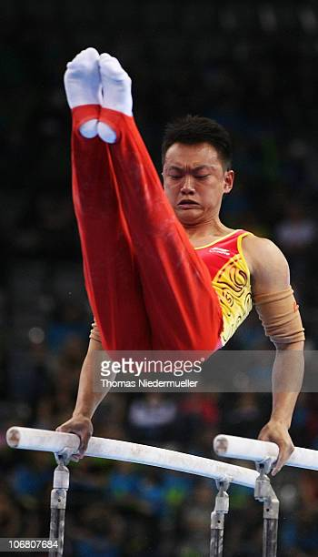 Guanying Wang of China performes at the parallel bars during the EnBW Gymnastics Worldcup 2010 at the Porsche Arena on November 13 2010 in Stuttgart...