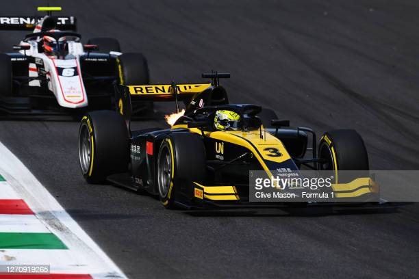 Guanyu Zhou of China and UNI-Virtuosi Racing leads Christian Lundgaard of Denmark and ART Grand Prix during the sprint race for the Formula 2...