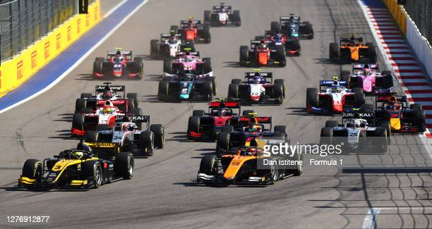 Guanyu Zhou of China and UNI-Virtuosi Racing leads Jack Aitken of Great Britain and Campos Racing and the rest of the field into turn two at the...