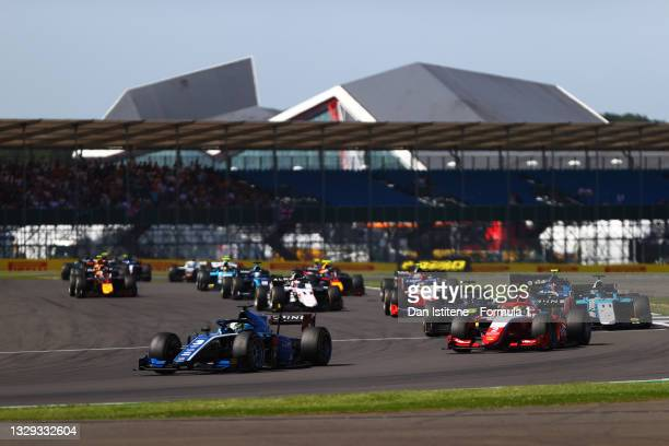 Guanyu Zhou of China and UNI-Virtuosi Racing leads Oscar Piastri of Australia and Prema Racing and the rest of the field on the first lap during the...