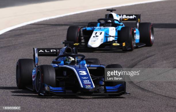 Guanyu Zhou of China and UNI-Virtuosi Racing leads Richard Verschoor of Netherlands and MP Motorsport during the Feature Race of Round 1:Sakhir of...