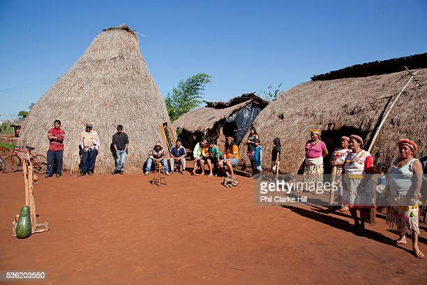 Guarani community watching a traditional dance The Guarani are one of the most populous indigenous populations in Brazil but with the least amount of...