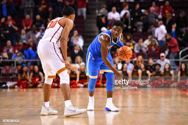 UCLA guard Aaron Holiday dribbles out the clock at the end of a college basketball game between the UCLA Bruins and the USC Trojans on March 3 at the...
