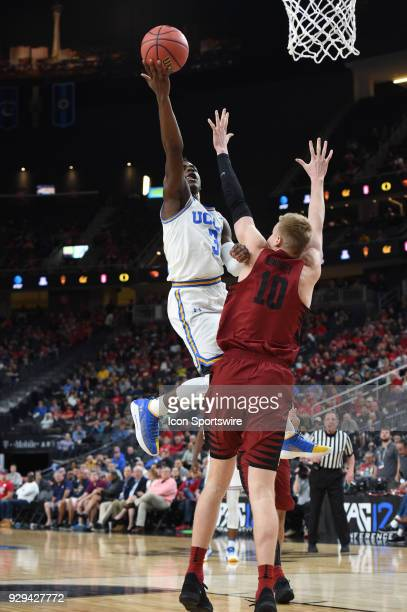 UCLA guard Aaron Holiday goes up for a shot as time expires on the clock in the first half during the PAC12 Men's Basketball Tournament game between...