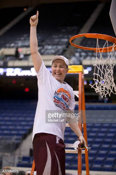 Guard Abigail Corning of the Fordham Rams cuts down a piece of the net after defeating the Dayton Flyers in the championship game of the womens...