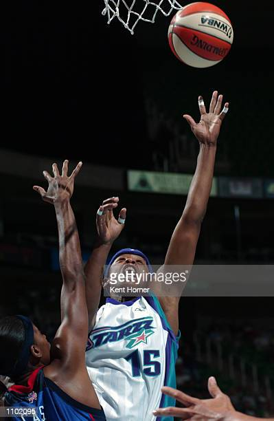 Guard Adrienne Goodson of the Utah Starzz shoots the ball over forward Swin Cash of the Detroit Shock during the game on July 8 2002 at Delta Center...