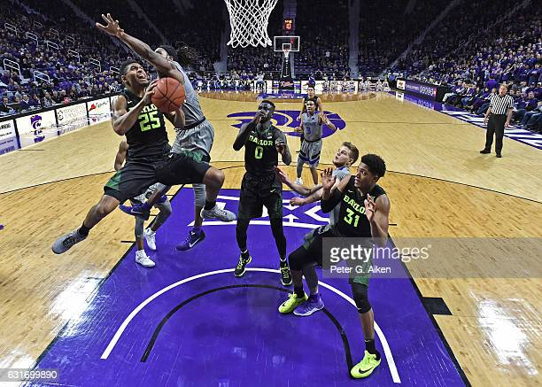 Guard Al Freeman of the Baylor Bears drives in for a basket against forward DJ Johnson of the Kansas State Wildcats during the second half on January...